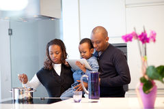 http://www.dreamstime.com/royalty-free-stock-photography-young-black-family-fresh-modern-kitchen-image22780677
